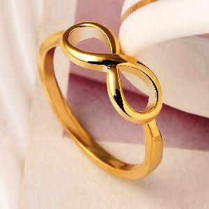 фото кольцо бесконечность золотое